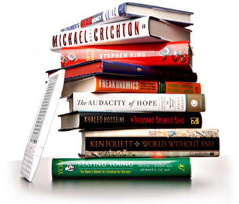 Escáner de libros que pasa las páginas con un aspirador